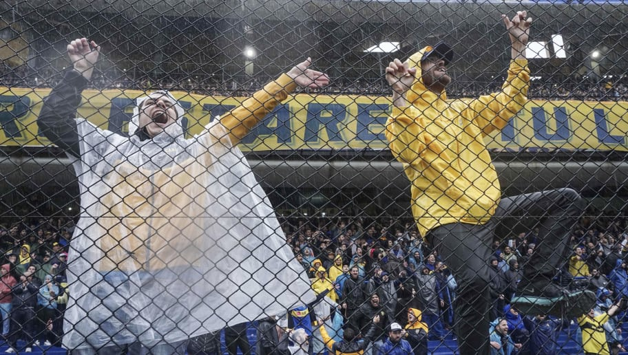 Argentinian Boca Juniors fans cheer their team after the Copa Libertadores 2018 final first leg football match at the Bombonera stadium was suspended in Buenos Aires, Argentina, on November 10, 2018. - The match was suspended due to heavy rains and will be played on Sunday, announced the Conmebol. (Photo by Eitan ABRAMOVICH / AFP)        (Photo credit should read EITAN ABRAMOVICH/AFP/Getty Images)