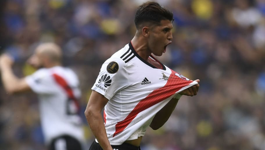River Plate's Exequiel Palacios celebrates after teammate Lucas Pratto (out of frame) scored their team's first goal against Boca Juniors, during their first leg match of the all-Argentine Copa Libertadores final, at La Bombonera stadium in Buenos Aires, on November 11, 2018. - River Plate twice came from behind to snatch a 2-2 draw with fierce rivals Boca Juniors in first leg of their weather-delayed 'Superclasico' Copa Libertadores final on Sunday. (Photo by Eitan ABRAMOVICH / AFP)        (Photo credit should read EITAN ABRAMOVICH/AFP/Getty Images)