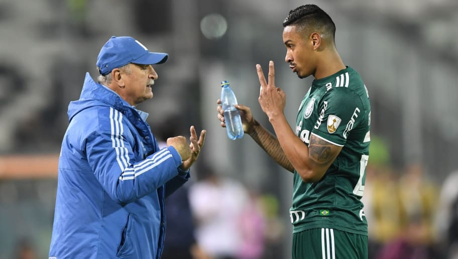Brazil's Palmeiras coach Luiz Felipe Scolari gives instruction to player Antonio Carlos (R) during a Copa Libertadores football match against Chilean Colo-Colo at the Monumental stadium in Santiago, Chile, on September 20, 2018. (Photo by MARTIN BERNETTI / AFP)        (Photo credit should read MARTIN BERNETTI/AFP/Getty Images)
