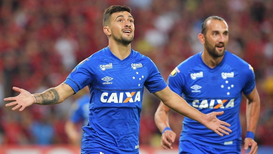 Brazil s Cruzeiro Giorgian De Arrascaeta (L) celebrates after scoring  against Brazil s Flamengo f7dae64372baf