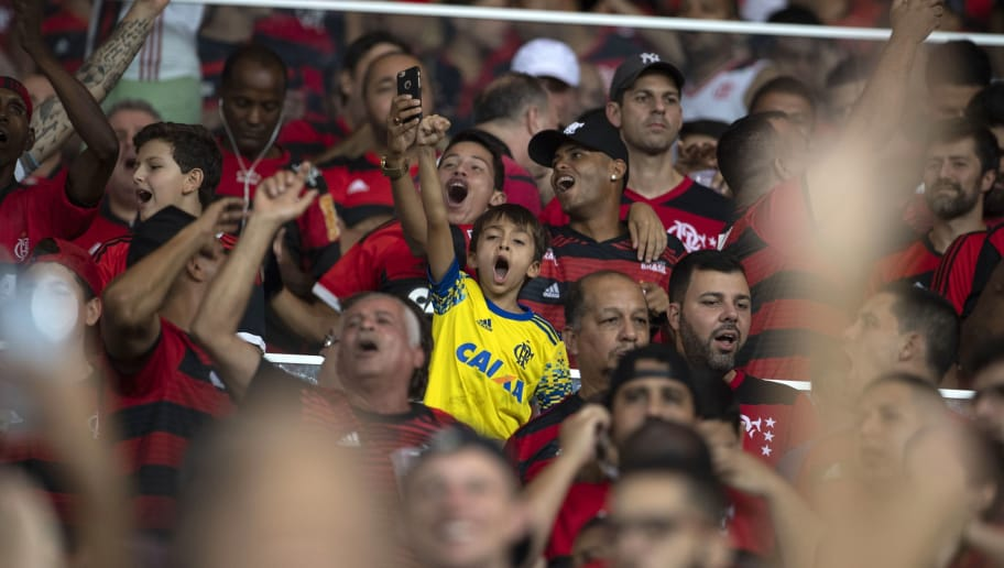Brazil's Flamengo supporters celebrate the victory against Ecuador's Emelec team during the Copa Libertadores 2018 football match between Brazil's Flamengo and Ecuador's Emelec at Maracana Stadium in Rio de Janeiro, Brazil, on May 16, 2018. (Photo by MAURO PIMENTEL / AFP)        (Photo credit should read MAURO PIMENTEL/AFP/Getty Images)