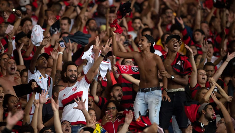 Brazil's Flamengo supporters celebrate their team won a Copa Libertadores 2018 football match against Ecuador's Emelec at Maracana Stadium in Rio de Janeiro, Brazil, on May 16, 2018. (Photo by MAURO PIMENTEL / AFP)        (Photo credit should read MAURO PIMENTEL/AFP/Getty Images)