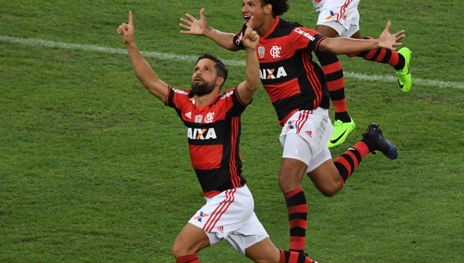 Brazil's Flamengo Diego Ribas (L) celebrates with teammate Willian Arao after scoring against Argentina's San Lorenzo during their Libertadores Cup football match at the Maracana stadium in Rio de Janeiro, Brazil on March 8, 2017.               / AFP PHOTO / VANDERLEI ALMEIDA        (Photo credit should read VANDERLEI ALMEIDA/AFP/Getty Images)