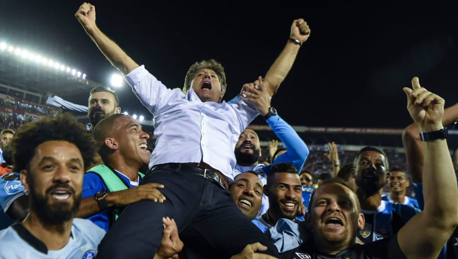 b9290cc75d55d Brazil s Gremio coach Renato Gaucho celebrates after his team defeats  Argentina s Lanus during the Copa Libertadores