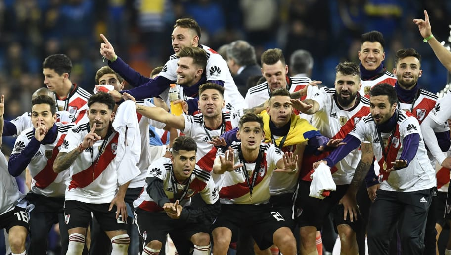 Players of River Plate celebrate after winning the second leg match of the all-Argentine Copa Libertadores final against Boca Juniors, at the Santiago Bernabeu stadium in Madrid, on December 9, 2018. - River Plate came from behind to beat bitter Argentine rivals Boca Juniors 3-1 in extra time. (Photo by OSCAR DEL POZO / AFP)        (Photo credit should read OSCAR DEL POZO/AFP/Getty Images)