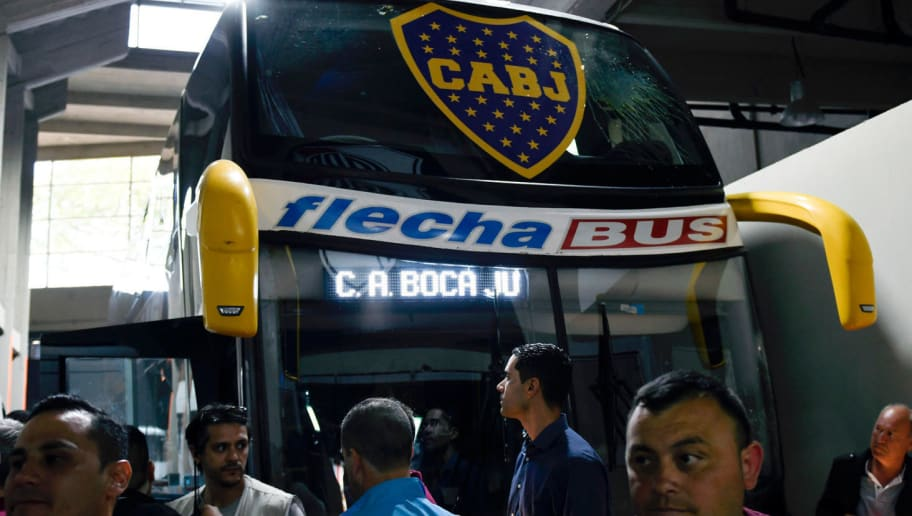 Picture released by DP via Noticias Argentinas showing the bus of Boca Juniors inside the Monumental stadium in Buenos Aires after it was attacked by fans of River Plate as it drove the footballers to play the all-Argentine Copa Libertadores second leg final match, on November 24, 2018. - Saturday's 'superclasico' Copa Libertadores final was postponed until Sunday following an attack on the Boca team bus that left players affected by smoke inhalation and broken glass. (Photo by jose brusco / NOTICIAS ARGENTINAS / AFP) / Argentina OUT / RESTRICTED TO EDITORIAL USE - MANDATORY CREDIT 'AFP PHOTO / NA / DP / JOSE BRUSCO' - NO MARKETING NO ADVERTISING CAMPAIGNS - DISTRIBUTED AS A SERVICE TO CLIENTS        (Photo credit should read JOSE BRUSCO/AFP/Getty Images)