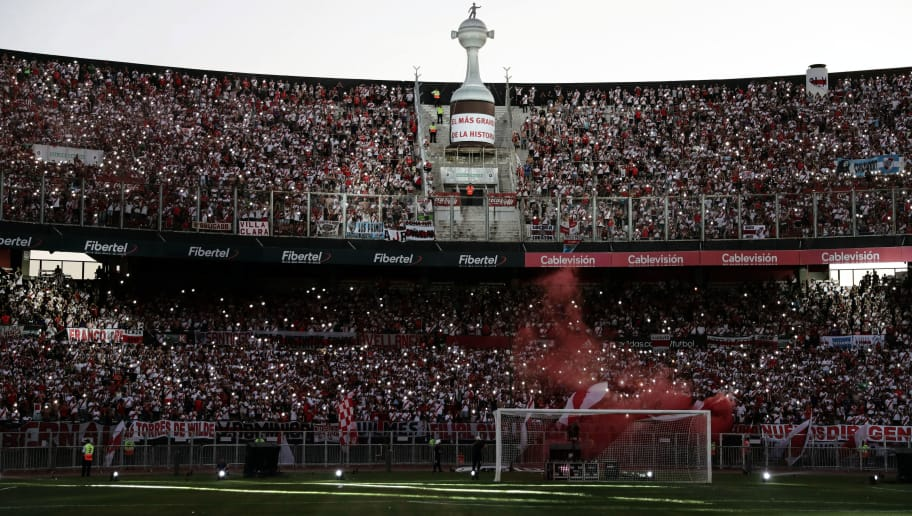 Fans of River Plate gather at the Monumental stadium in Buenos Aires on December 23, 2018,  to celebrate their team's triumph in the all-Argentine Copa Libertadores final, after beating arch rival Boca Juniors by 3-1 in Madrid on December 9, 2018, in a controversial second leg that was postponed twice due to fan violence and which was finally played abroad. - River Plate's team members arrived in Argentina after participating in the the FIFA Club World Cup in the United Arab Emirates and obtaining the third place. (Photo by ALEJANDRO PAGNI / AFP)        (Photo credit should read ALEJANDRO PAGNI/AFP/Getty Images)