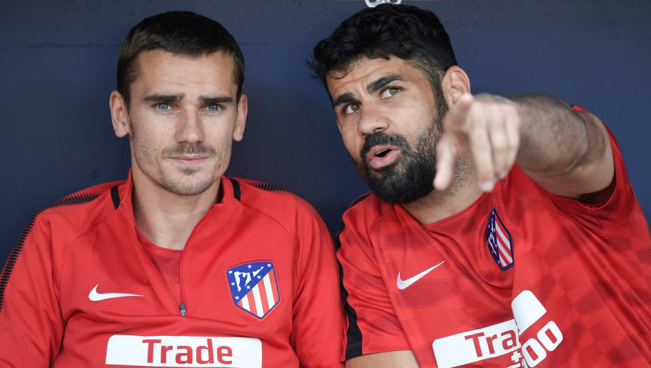 Atletico Madrid's Spanish forward Diego Costa speaks to Atletico Madrid's French forward Antoine Griezmann (L) on the bench during the Spanish league football match between Club Atletico de Madrid and SD Eibar at the Wanda Metropolitano stadium in Madrid on May 20, 2018. (Photo by GABRIEL BOUYS / AFP)        (Photo credit should read GABRIEL BOUYS/AFP/Getty Images)