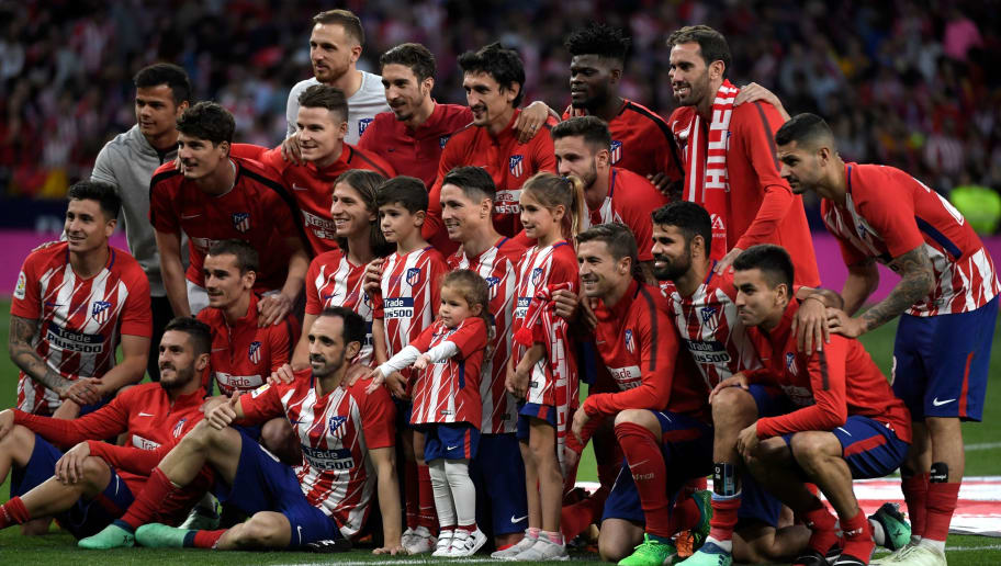 Atletico Madrid's Spanish forward Fernando Torres and his children Nora, Leo and Elsa pose with his teammates during a tribute at the end of the Spanish league football match between Club Atletico de Madrid and SD Eibar at the Wanda Metropolitano stadium in Madrid on May 20, 2018. - Torres scored twice in what was his final match for Atletico Madrid. (Photo by GABRIEL BOUYS / AFP)        (Photo credit should read GABRIEL BOUYS/AFP/Getty Images)