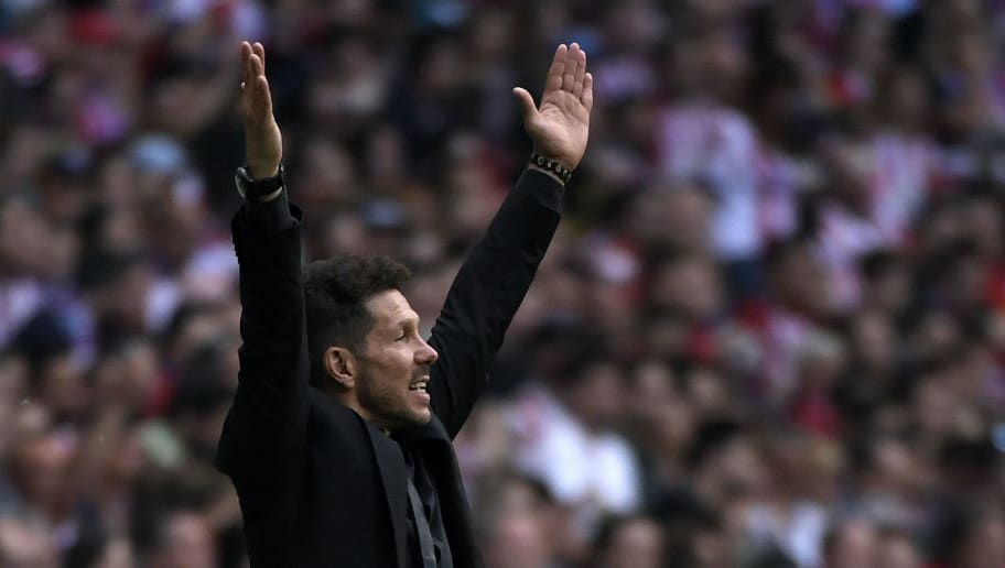 Atletico Madrid's Argentinian coach Diego Simeone reacts during the Spanish league football match between Club Atletico de Madrid and SD Eibar at the Wanda Metropolitano stadium in Madrid on May 20, 2018. (Photo by GABRIEL BOUYS / AFP)        (Photo credit should read GABRIEL BOUYS/AFP/Getty Images)