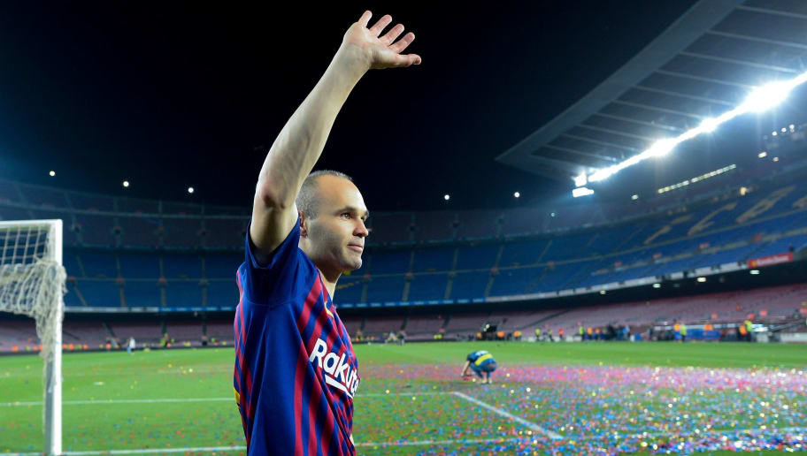 Barcelona's Spanish midfielder Andres Iniesta waves at the end of a tribute after the Spanish league football match between FC Barcelona and Real Sociedad at the Camp Nou stadium in Barcelona on May 20, 2018. - Iniesta, who joined Barcelona's academy 22 years ago, played his final game for the club. (Photo by Josep LAGO / AFP)        (Photo credit should read JOSEP LAGO/AFP/Getty Images)