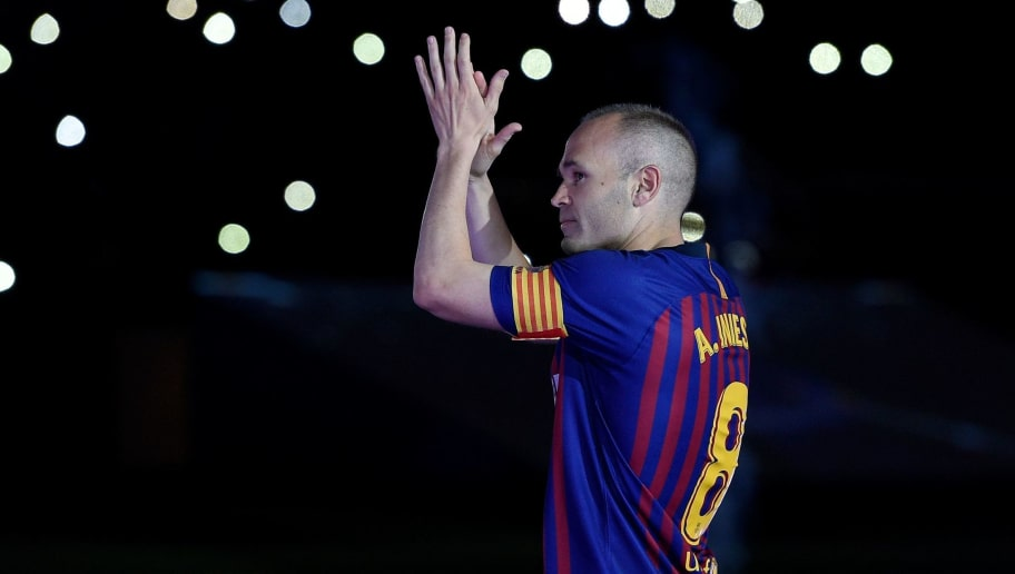 Barcelona's Spanish midfielder Andres Iniesta acknowledges fans during a tribute at the end of the Spanish league football match between FC Barcelona and Real Sociedad at the Camp Nou stadium in Barcelona on May 20, 2018. - Iniesta, who joined Barcelona's academy 22 years ago, played his final game for the club. (Photo by LLUIS GENE / AFP)        (Photo credit should read LLUIS GENE/AFP/Getty Images)