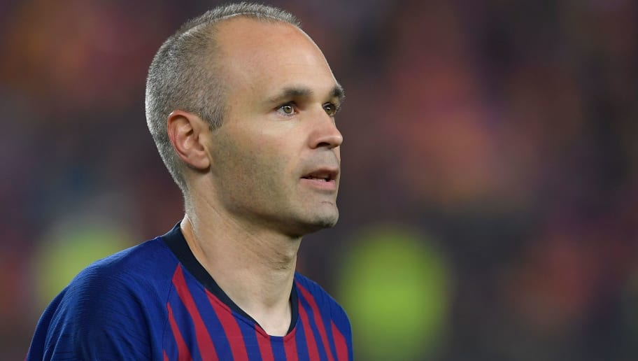 Barcelona's Spanish midfielder Andres Iniesta walks off the pitch at the end of the Spanish league football match between FC Barcelona and Real Sociedad at the Camp Nou stadium in Barcelona on May 20, 2018. - Iniesta, who joined Barcelona's academy 22 years ago, played his final game for the club. (Photo by LLUIS GENE / AFP)        (Photo credit should read LLUIS GENE/AFP/Getty Images)