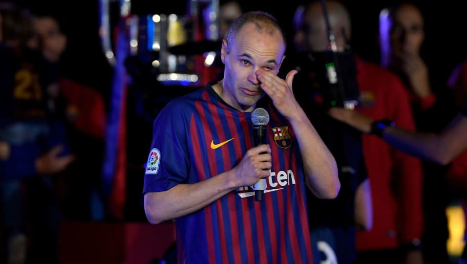 Barcelona's Spanish midfielder Andres Iniesta wipes his tears as he addresses fans during a tribute after the Spanish league football match between FC Barcelona and Real Sociedad at the Camp Nou stadium in Barcelona on May 20, 2018. - Iniesta, who joined Barcelona's academy 22 years ago, played his final game for the club. (Photo by LLUIS GENE / AFP)        (Photo credit should read LLUIS GENE/AFP/Getty Images)