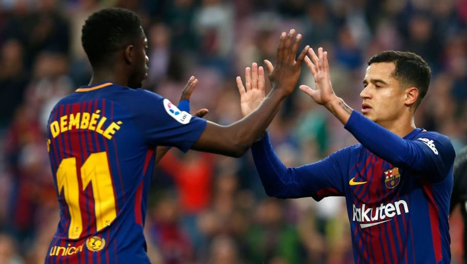 Barcelona's Brazilian midfielder Philippe Coutinho (R) celebrates with Barcelona's French forward Ousmane Dembele after scoring a goal during the Spanish league football match between Barcelona and Villarreal at the Camp Nou Stadium in Barcelona on May 9, 2018. (Photo by Pau Barrena / AFP)        (Photo credit should read PAU BARRENA/AFP/Getty Images)