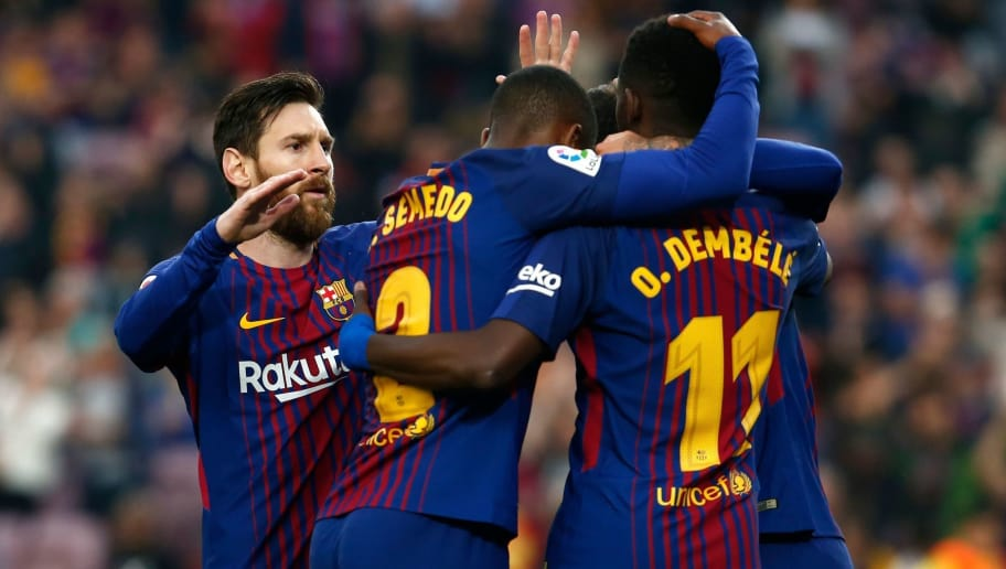 (L-R) Barcelona's Argentinian forward Lionel Messi, Barcelona's Portuguese defender Nelson Semedo and Barcelona's French forward Ousmane Dembele celebrate a goal during the Spanish league football match between Barcelona and Villarreal at the Camp Nou Stadium in Barcelona on May 9, 2018. (Photo by Pau Barrena / AFP)        (Photo credit should read PAU BARRENA/AFP/Getty Images)