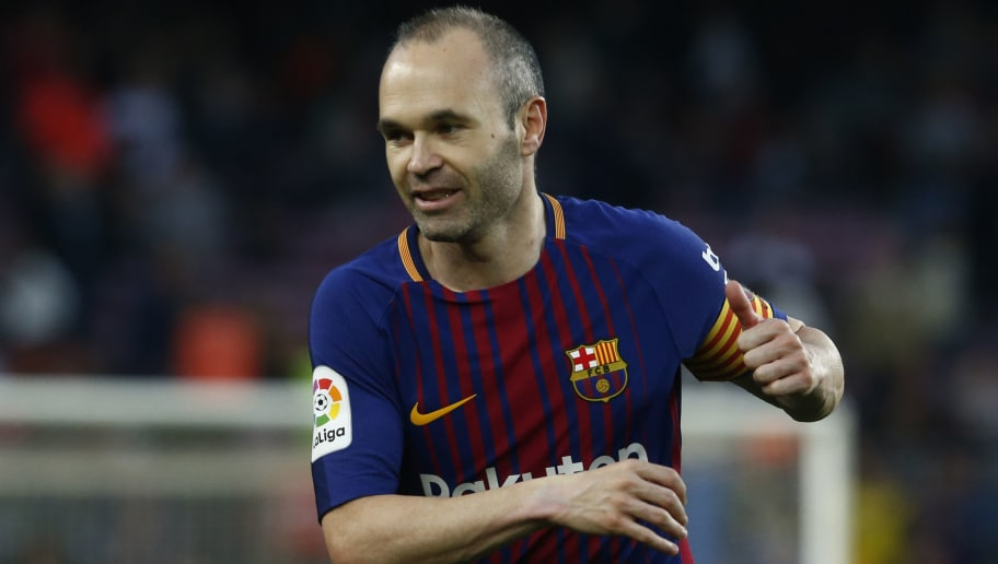 Barcelona s Spanish midfielder Andres Iniesta reacts during the Spanish  league football match between Barcelona and Villarreal ac438bac08a5e