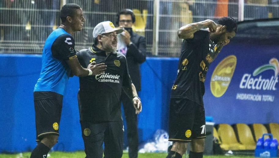 Argentine legend Diego Maradona (C) celebrates a goal with player Vinicio Angulo (R) during his first match as coach of Mexican second-division club Dorados, against Cafetaleros, at the Banorte stadium in Culiacan, Sinaloa State, Mexico, on September 17, 2018. (Photo by RASHIDE FRIAS / AFP)        (Photo credit should read RASHIDE FRIAS/AFP/Getty Images)