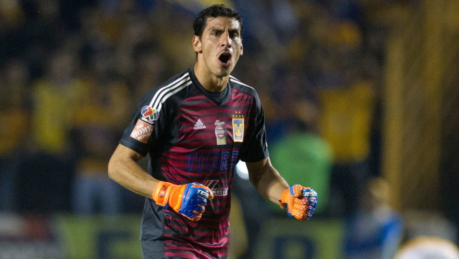 Tigres goalkeeper Nahuel Guzman celebrates after his team scored against Pumas during the first leg of the quarterfinal of the Mexican Apertura 2018 tournament football match at the Universitario stadium in Monterrey, Mexico, on November 29, 2018. (Photo by Julio Cesar AGUILAR / AFP)        (Photo credit should read JULIO CESAR AGUILAR/AFP/Getty Images)
