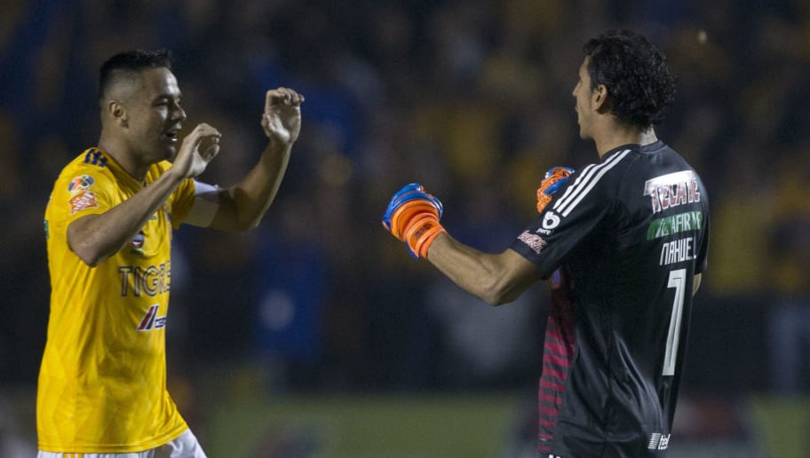 Tigres goalkeeper Nahuel Guzman celebrates with a teammate after scoring against Pumas during the first leg of the quarterfinal of the Mexican Apertura 2018 tournament football match at the Universitario stadium in Monterrey, Mexico on November 29, 2018. (Photo by Julio Cesar AGUILAR / AFP)        (Photo credit should read JULIO CESAR AGUILAR/AFP/Getty Images)