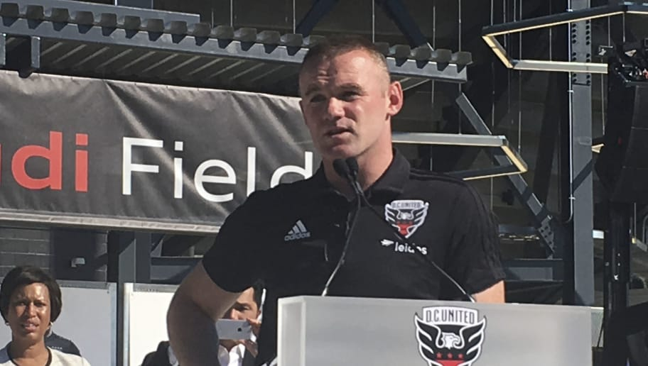 DC United player Wayne Rooney speaks during a press conference at a Digital Assets & Audi Field ribbon cutting ceremony on July 9, 2018 in Washington,DC. - United hosted a ribbon cutting ceremony and housewarming party to celebrate the opening of their new state-of-the-art and soccer-specific stadium at Audi Field. (Photo by Gilles CLARENNE / AFP)        (Photo credit should read GILLES CLARENNE/AFP/Getty Images)
