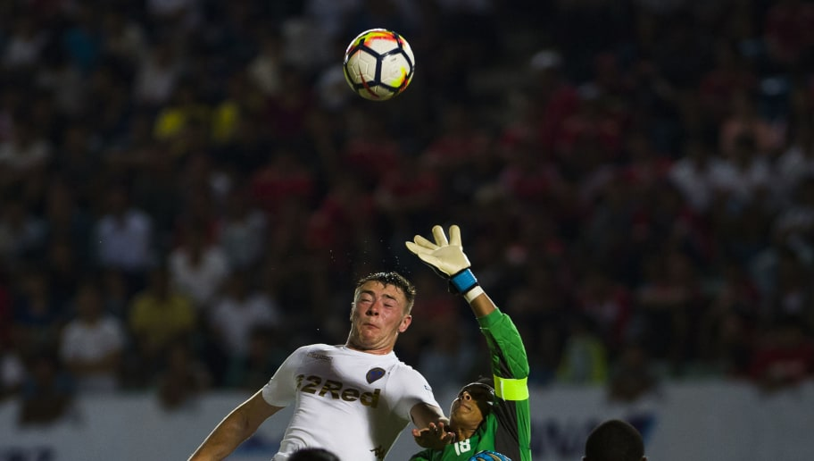 Ryan David Edmondson Leeds United FC (L) fights for ball during their match with the Myanmar National League All Star football team at Thuwana football staduim in Yangon on May 9, 2018. - Leeds United arrived in Myanmar May 8 to kick off an end-of-season tour mired in controversy over whether the second tier Championship team should be playing in a country that the UN accuses of ethnic cleansing against its minority Rohingya Muslim community. (Photo by YE AUNG THU / AFP)        (Photo credit should read YE AUNG THU/AFP/Getty Images)