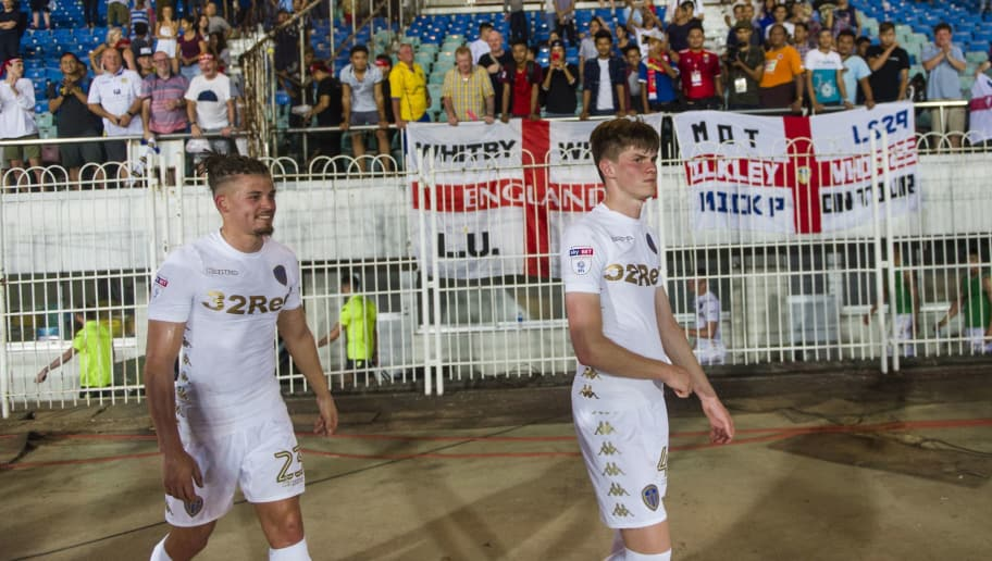 Kalvin Mark Phillips (L) and Tom Mark Pearce of Leeds United FC greet fans during the Leeds United FC and Myanmar National League All Star football match at Thuwana football staduim in Yangon on May 9, 2018. - Leeds United arrived in Myanmar May 8 to kick off an end-of-season tour mired in controversy over whether the second tier Championship team should be playing in a country that the UN accuses of ethnic cleansing against its minority Rohingya Muslim community. (Photo by YE AUNG THU / AFP)        (Photo credit should read YE AUNG THU/AFP/Getty Images)