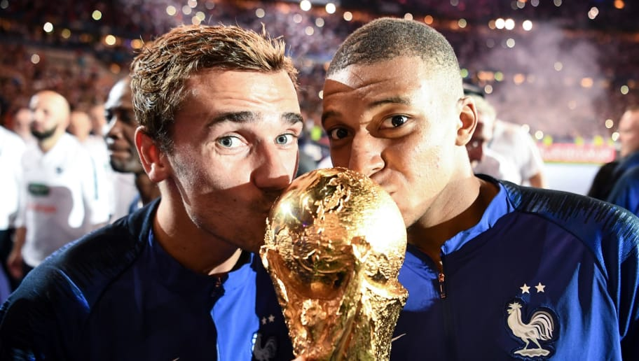France's forward Antoine Griezmann (L) and France's midfielder Kylian Mbappe (R) kiss the 2018 World Cup trophy as they celebrate during a ceremony for the victory of the 2018 World Cup at the end of the UEFA Nations League football match between France and Netherlands at the Stade de France stadium, in Saint-Denis, northern of Paris, on September 9, 2018. (Photo by FRANCK FIFE / AFP)        (Photo credit should read FRANCK FIFE/AFP/Getty Images)