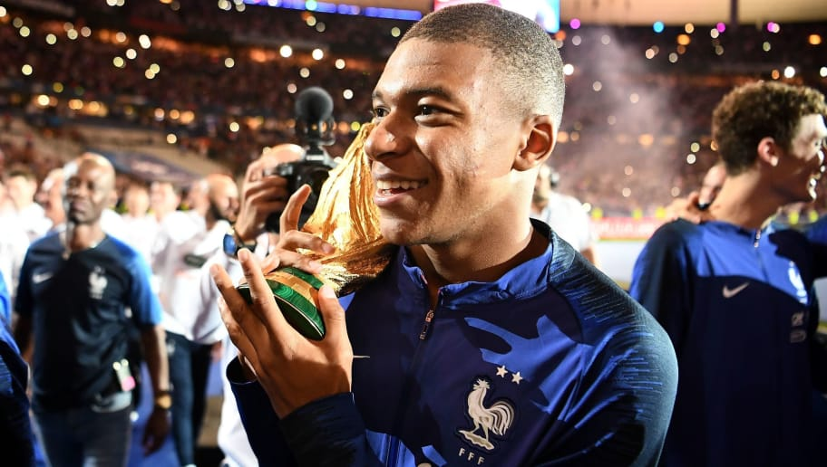 France's forward Kylian Mbappe (C) celebrates as they do a lap of honour during a ceremony to celebrate the victory of the 2018 World Cup at the end of the UEFA Nations League football match between France and Netherlands at the Stade de France stadium, in Saint-Denis, northern of Paris, on September 9, 2018. (Photo by FRANCK FIFE / AFP)        (Photo credit should read FRANCK FIFE/AFP/Getty Images)