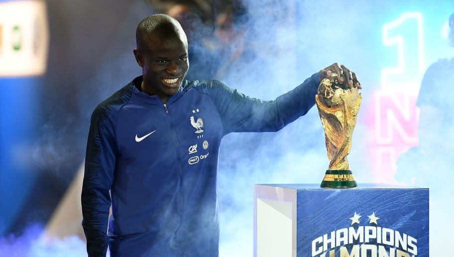 France's midfielder N'Golo Kante looks the 2018 World Cup trophy during a ceremony to celebrate the victory of the 2018 World Cup before the lap of honour at the end of the UEFA Nations League football match between France and Netherlands at the Stade de France stadium, in Saint-Denis, northern of Paris, on September 9, 2018. (Photo by FRANCK FIFE / AFP)        (Photo credit should read FRANCK FIFE/AFP/Getty Images)
