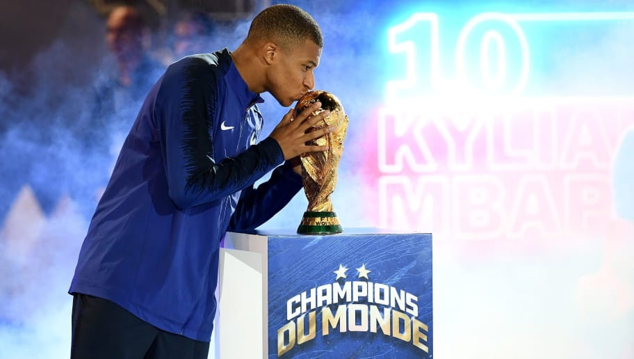 France's midfielder Kylian Mbappe kisses the World Cup trophy during a ceremony to celebrate the victory of the 2018 World Cup at the end of the UEFA Nations League football match between France and Netherlands at the Stade de France stadium, in Saint-Denis, northern of Paris, on September 9, 2018. (Photo by FRANCK FIFE / AFP)        (Photo credit should read FRANCK FIFE/AFP/Getty Images)