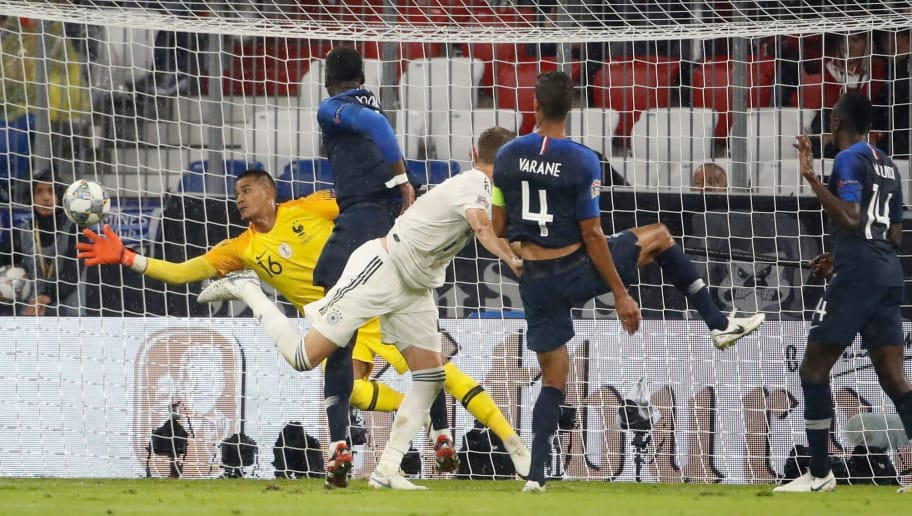France's goalkeeper Alphonse Areola (L) makes a save during the UEFA Nations League football match Germany against France on September 6, 2018 in Munich, southern Germany. (Photo by Odd ANDERSEN / AFP)        (Photo credit should read ODD ANDERSEN/AFP/Getty Images)