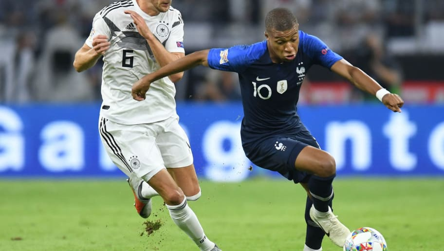 Germany's midfielder Leon Goretzka (L) and France's midfielder Kylian Mbappe vie for the ball during the UEFA Nations League football match Germany against France on September 6, 2018 in Munich, southern Germany. (Photo by Christof STACHE / AFP)        (Photo credit should read CHRISTOF STACHE/AFP/Getty Images)