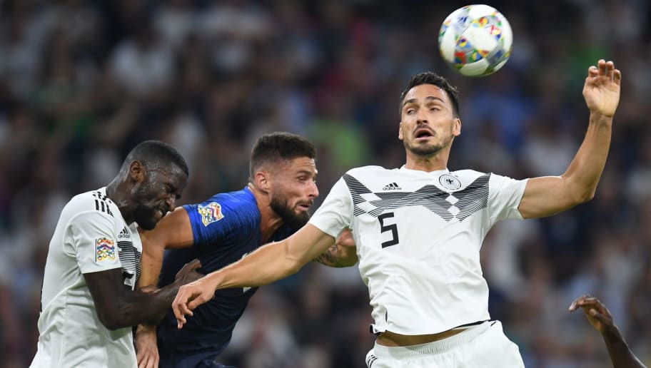 (L to R) Germany's defender Antonio Ruediger, France's forward Olivier Giroud and Germany's defender Mats Hummels vie for the ball during the UEFA Nations League football match Germany against France on September 6, 2018 in Munich, southern Germany. (Photo by Christof STACHE / AFP)        (Photo credit should read CHRISTOF STACHE/AFP/Getty Images)