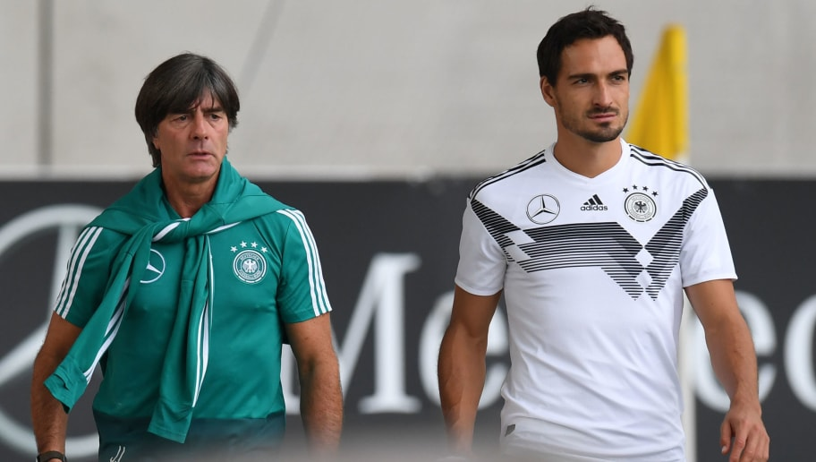 Germany's head coach Joachim Loew (L) and Germany's defender Matts Hummels (R) arrive for the training of the German national football team in Munich, southern Germany, on September 4, 2018. - Germany will play in the UEFA Nations League against the France in Munich, southern Germany, on September 6, 2018. (Photo by Christof STACHE / AFP)        (Photo credit should read CHRISTOF STACHE/AFP/Getty Images)