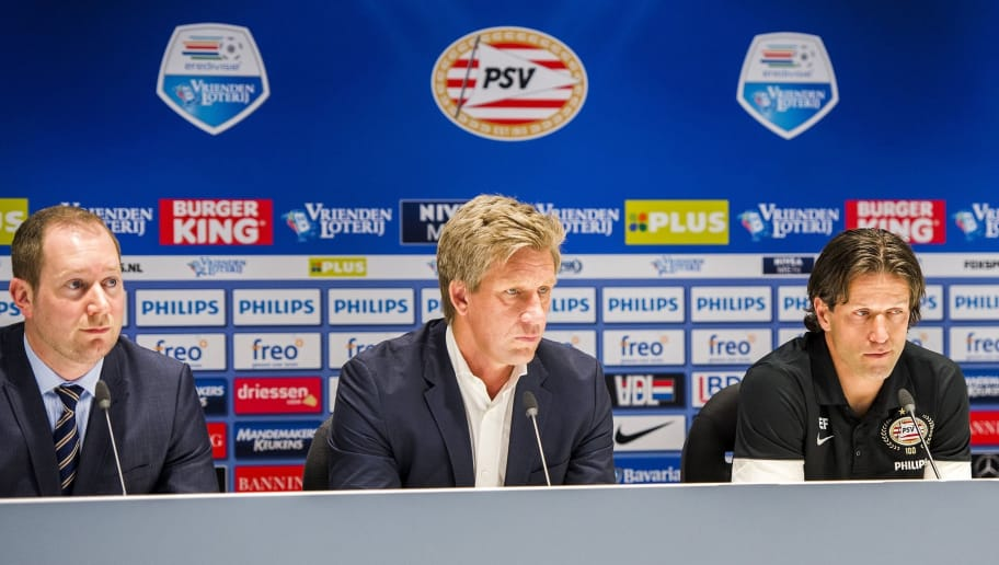 (From L) Dutch football club PSV Eindhoven press officer Jeroen van den Berk, technical director Marcel Brands, assistant trainer Ernest Faber and player Stijn Schaars give a press conference on the physical condition of PSV head coach Philip Cocu in Eindhoven, The Netherlands, on March 28, 2014. Cocu had a tumor removed from his back on March 27 and will not be able to coach until the next footbqall season. AFP PHOTO / ANP - REMKO DE WAAL - netherlands out (Photo by - / ANP / AFP)        (Photo credit should read -/AFP/Getty Images)