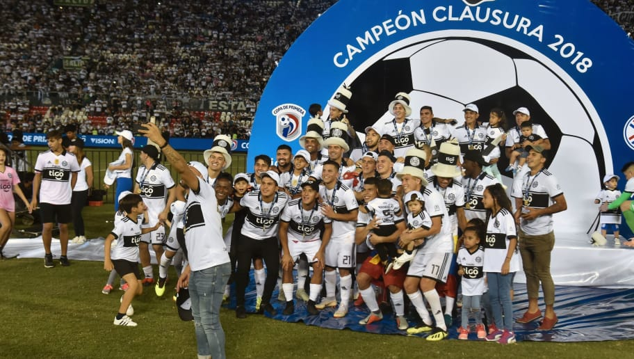 Olimpia's players celebrate after winning the Paraguayan Clausura 2018 tournament at the Defensores del Chaco stadium in Asuncion, on November  28, 2018. - Olimpia defeated Guarani by 4-1. (Photo by NORBERTO DUARTE / AFP)        (Photo credit should read NORBERTO DUARTE/AFP/Getty Images)
