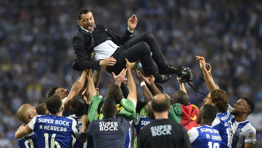 Porto's players carry their Portuguese coach Sergio Conceicao as they celebrate winning the league title after the Portuguese league football match between FC Porto and CD Feirense at the Dragao stadium in Porto on May 6, 2018. (Photo by MIGUEL RIOPA / AFP)        (Photo credit should read MIGUEL RIOPA/AFP/Getty Images)