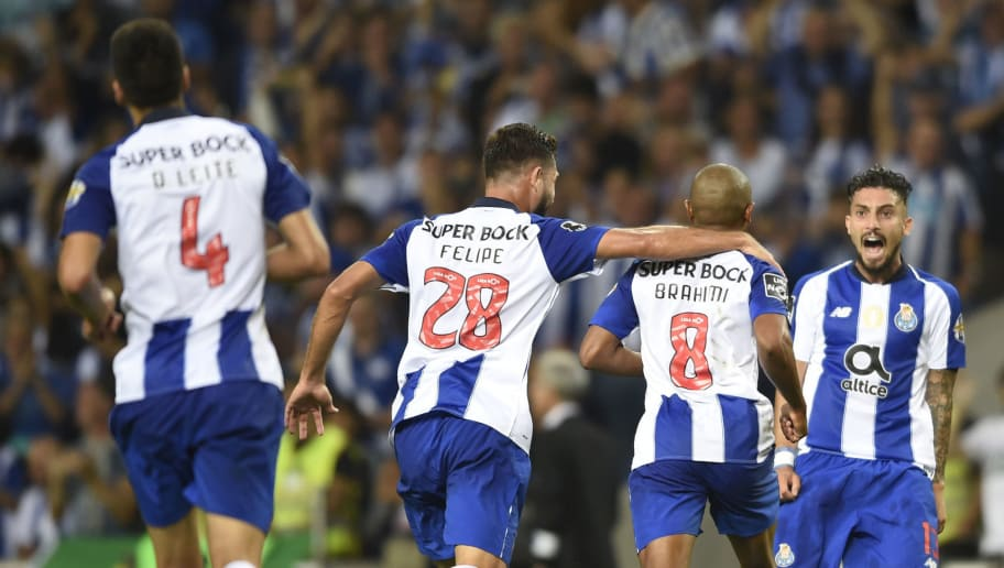 Porto's Algerian forward Yacine Brahimi (2R) celebrates scoring a goal with teammates during the Portuguese league football match between FC Porto and Vitoria Guimaraes SC at the Dragao stadium in Porto on August 25, 2018. (Photo by MIGUEL RIOPA / AFP)        (Photo credit should read MIGUEL RIOPA/AFP/Getty Images)
