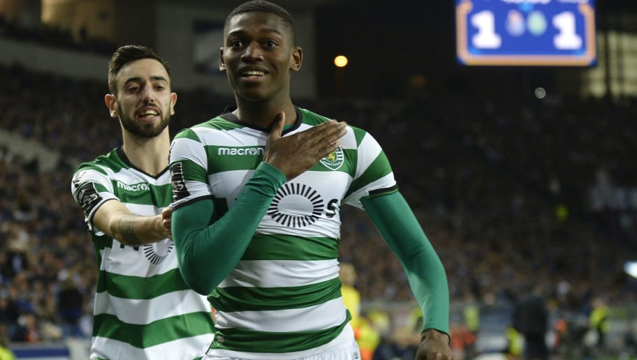 Sporting's Portuguese forward Rafael Leao (R) celebrates a goal with teammate Portuguese midfielder Bruno Fernandes during the Portuguese league football match FC Porto against Sporting CP at the Dragao stadium in Porto on March 02, 2018. / AFP PHOTO / MIGUEL RIOPA        (Photo credit should read MIGUEL RIOPA/AFP/Getty Images)