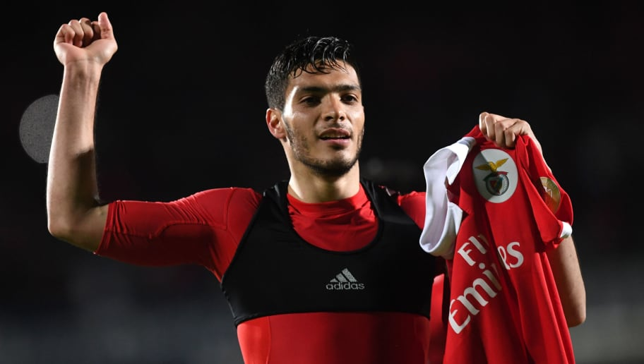 Benfica's Mexican forward Raul Jimenez holds his jersey as he celebrates after scoring a goal during the Portuguese league football match between Vitoria Setubal FC and SL Benfica at the Bonfim stadium in Setubal on April 7, 2018. / AFP PHOTO / FRANCISCO LEONG        (Photo credit should read FRANCISCO LEONG/AFP/Getty Images)