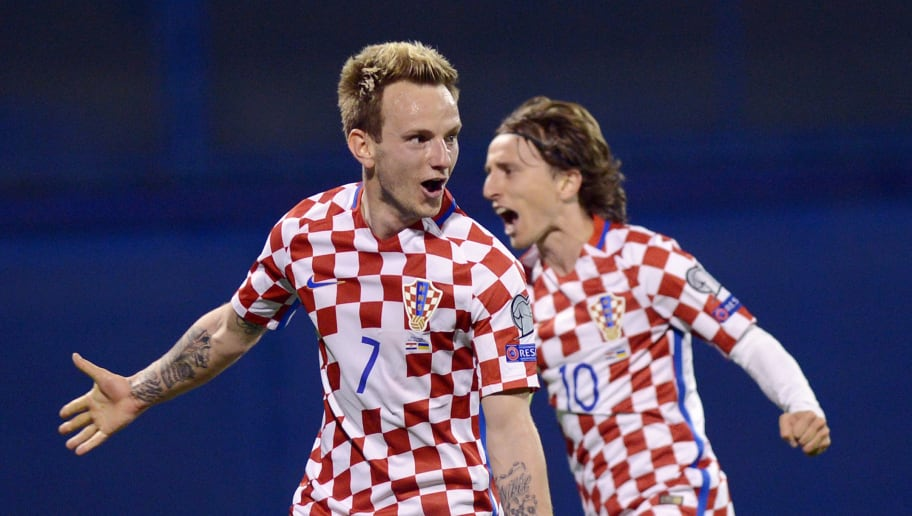 Croatia's midfielders  Luka Modric  (R) and Ivan Rakitic celebrate after scoring a goal during the FIFA World Cup 2018 qualification football match between Croatia and Ukraine  in Zagreb on March 24, 2017.  / AFP PHOTO / STRINGER        (Photo credit should read STRINGER/AFP/Getty Images)