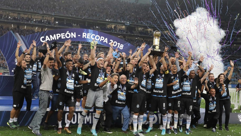 Brazilís Gremio players celebrate with the trophy after winning the Recopa Sudamericana 2018 final match against Argentina's Independiente at Arena Gremio, in Porto Alegre, Brazil, on February 21, 2018. / AFP PHOTO / ITAMAR AGUIAR        (Photo credit should read ITAMAR AGUIAR/AFP/Getty Images)