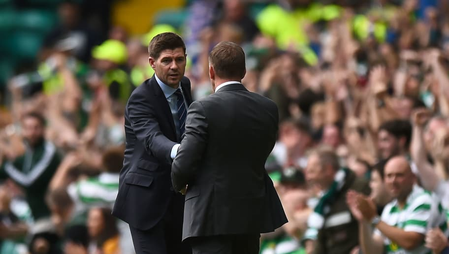 Ranger's English manager Steven Gerrard (L) and Celtic's Northern Irish manager Brendan Rodgers shake hands after the Scottish Premiership football match between Celtic and Rangers at Celtic Park stadium in Glasgow, Scotland on September 2, 2018. (Photo by ANDY BUCHANAN / AFP)        (Photo credit should read ANDY BUCHANAN/AFP/Getty Images)