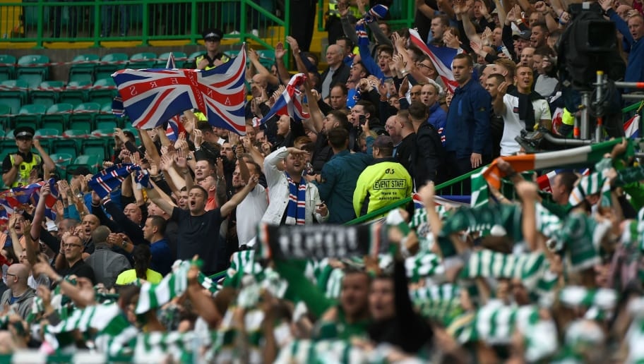 Rangers supporters (L) and Celtic (R) supporters prepare for the Scottish Premiership football match between Celtic and Rangers at Celtic Park stadium in Glasgow, Scotland on September 2, 2018. (Photo by ANDY BUCHANAN / AFP)        (Photo credit should read ANDY BUCHANAN/AFP/Getty Images)
