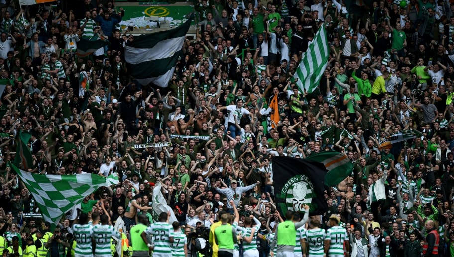 Celtic's supporters cheer the players after the Scottish Premiership football match between Celtic and Rangers at Celtic Park stadium in Glasgow, Scotland on September 2, 2018. (Photo by ANDY BUCHANAN / AFP)        (Photo credit should read ANDY BUCHANAN/AFP/Getty Images)