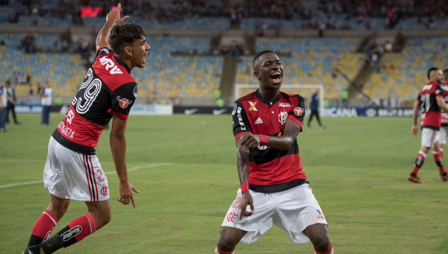 Brazil's Flamengo player Vinicius Jr (R) and Lucas Paqueta celebrate qualifying for the 2017 Sudamericana Cup semifinals at Maracana stadium in Rio de Janeiro, Brazil, on November 01, 2017.  / AFP PHOTO / Mauro PIMENTEL        (Photo credit should read MAURO PIMENTEL/AFP/Getty Images)
