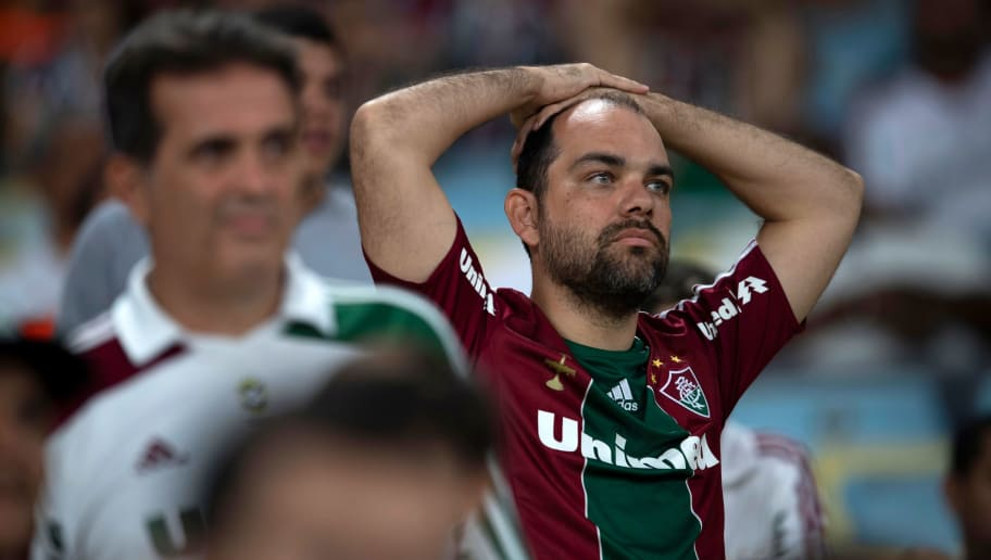 Brazil's Fluminense supporters reacts during the Copa Sudamericana 2018 football match between Brazil's Fluminense and Brazil's Atletico Paranaense at Maracana stadiumin Rio de Janeiro, Brazil, on November 28, 2018. (Photo by Mauro Pimentel / AFP)        (Photo credit should read MAURO PIMENTEL/AFP/Getty Images)