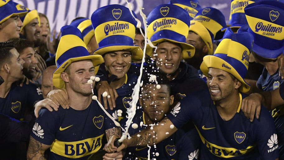 Boca Junior's football celebrate after winning the Argentina First Division Superliga championship after a tie with Gimnasia y Esgrima La Plata at Juan Carmelo Zerillo stadium in La Plata, Buenos Aires, Argentina, on May 9, 2018. (Photo by JUAN MABROMATA / AFP)        (Photo credit should read JUAN MABROMATA/AFP/Getty Images)