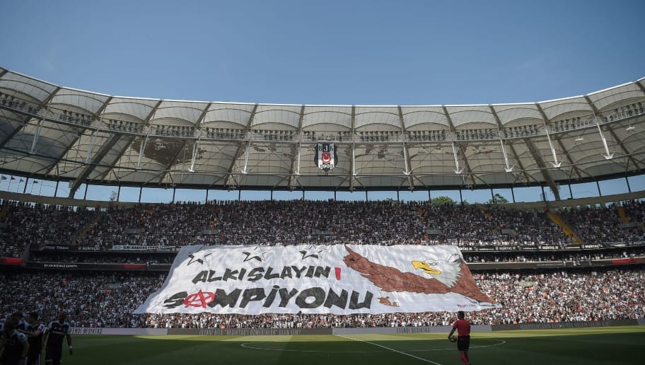 Besiktas' fans hold a banner reading ' Applause the Champion!' during the Turkish Spor Toto Super league football match between Besiktas and Osmanlispor at the vodafone Park stadium on June 3, 2017 in Istanbul.  / AFP PHOTO / OZAN KOSE        (Photo credit should read OZAN KOSE/AFP/Getty Images)